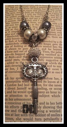 Owl Antique Key Charm Necklace. Cute combination of two things I love!!
