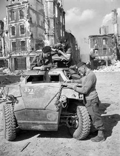 The crew of a Humber I scout car receiving orders, Falaise, France, 17 August 1944