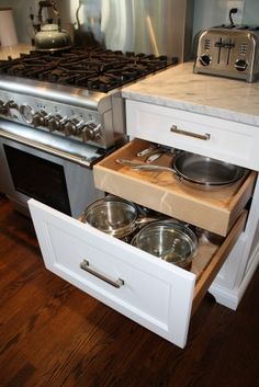 Double drawer for pots and pans; shallow pans in top tier.