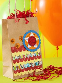 Loot bag made from patterned paper and a paper bag by Vicki Boutin