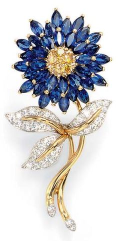 A SAPPHIRE AND COLORED DIAMOND BROOCH, BY OSCAR HEYMAN & BROTHERS Set with a pavé-set yellow diamond bombé pistil, extending three tiers of marquise-cut sapphire petals, to the gold and diamond stem, with circular-cut diamond leaves, mounted in platinum and 18k gold By Oscar Heyman & Brothers