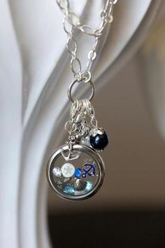 Nautical theme locket. Great for summer! Discover it at www.Cameron.origamiowl.com