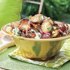 Big Daddy's Grilled Blue Cheese-and-Bacon Potato Salad | Filled with red onion, blue cheese, bacon, and a sweet-tangy dressing, this reader recipe earned top honors at our test kitchen tastings. | #Recipes | SouthernLiving.com