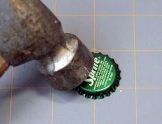hammering the bottle cap necklace