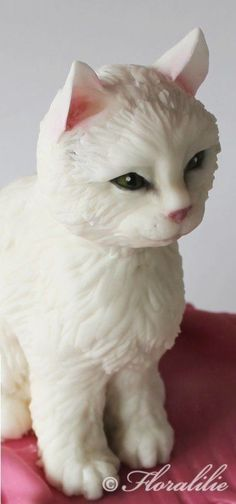 Cat cake is made from modeled rice krispie treats and covered in white chocolate ganache and fondant.
