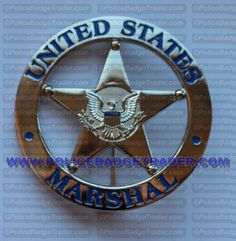 US Marshal (silver) badge Available from www.policebadgetrader.com