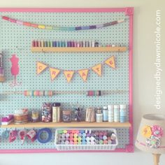 DIY Craft Room Jumbo Framed Pegboard Wall submitted to InspirationDIY.com