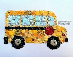 Button Art Button School Bus with Swarovski Rhinestones. Great back to school teacher gift! #buttonart #buttons #swarovski #handmade #crafts #diy #art #teaching #education #backtoschool #apple #teacher #giftsforteacher #buttonandswarovski #schoolbus #buttonbus #yellowbus #elementaryschool