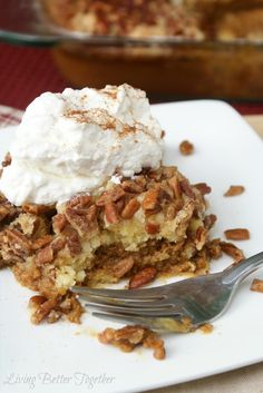 Pumpkin Crumble Cake by Living Better Together. A layer of pumpkin pie, layered with a crumbly yellow cake, topped with nuts. Served warm with fresh whipped cream and cinnamon. The perfect dessert for fall!