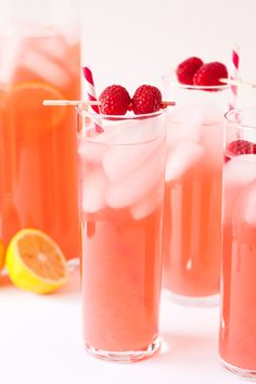 1 large bottle of Moscato wine, 1 can of raspberry lemonade concentrate, a splash of sprite, crushed raspberries.
