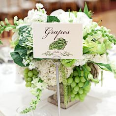 centerpiece utilizing flowers, grapes, and cabbage leaves!