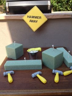 Our Medley of Memories: Dump Truck Birthday Party Décor - awesome party idea!  Plastic hammers, golf tees, and Styrofoam blocks!