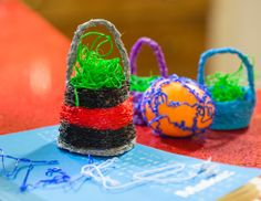The 3Doodler is 3D printing pen, which is as easy to use as a glue gun. Here we made some cute little Easter baskets.