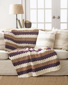 Add an air of elegance to your home decor with this chic Chevron Blanket. Shown in Bernat Worsted.