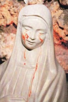 Statue of BVM in Civitavecchia, Italy crying tears of blood