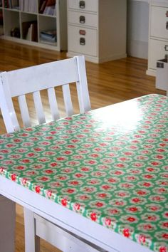 oilcloth covered table. I keep meaning to do this with or table, which is permenantly covered in an oilcloth tablecloth. Much nicer to attach it to the table.