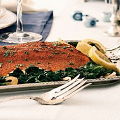 Spice-Rubbed Roasted Salmon with Lemon-Garlic Spinach Recipe from Cooking Light.  Ingredients: cumin, coriander, paprika, cinnamon, black pepper, skinless salmon fillet, sliced onion. For the spinach: olive oil, garlic, baby spinach, grated lemon rind + lemon juice, cilantro