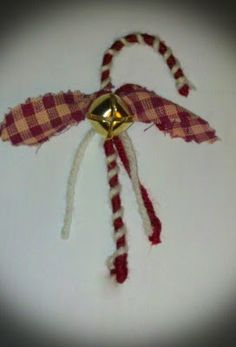 Cute yarn wrapped wire candy cane ornaments.  An easy, inexpensive DIY way to decorate the tree. love it must try! #ecrafty