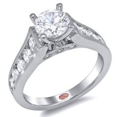 Designer Engagement Rings from DemarcoJewelry.com  Available in White or Yellow Gold 18KT and Platinum. 1.82 RDCapture her grace and endless beauty with this confident yet elegant design. We have also incorporated a unique pink diamond with every single one of our rings, symbolizing that hidden, unspoken emotion and feeling one carries in their heart about their significant other. This is not just another ring, this is a heirloom piece of jewelry.   Demarco Bridal Engagement Ring.