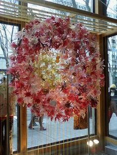 These flowers are made from cut up and painted bottles.  Gorgeous!  (An Anthropologie window display, of course.)