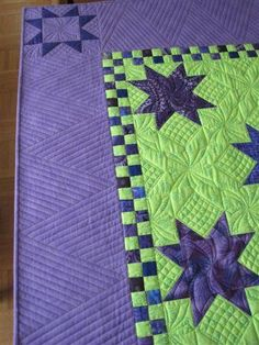 Love the quilting in the alternate blocks. Like the border treatment too