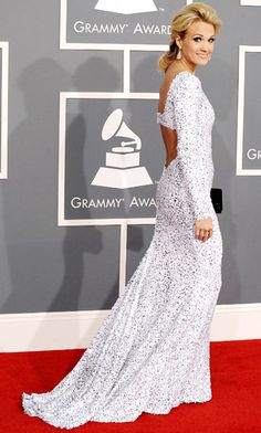 """Carrie Underwood singer wore Gomez-Gracia's long-sleeve backless """"Starlet"""" gown featuring intricately embroidered sequins on tulle."""