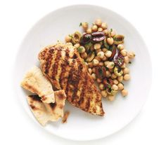 Grilled Spiced Chicken With Chickpeas recipe: Paprika and oregano liven up simply grilled chicken breasts, while the chickpea salad lends a tangy, nutty note.