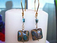 Debe's Gems design & creation.  2in in length.  Approx 15mm square Lampwork beads & 4mm Glass with metallic Teal color on the inside.  Wire wrapped & hung on 24k gold Vermeil French hooks.  Hooks,  Just under an inch in length, are large to add a BOLD flavor.  $14.00.