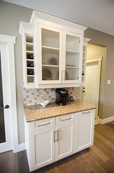 Station with frosted glass quartz countertops and built in wine