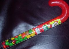 plastic candy cane shaped container w/ M candy