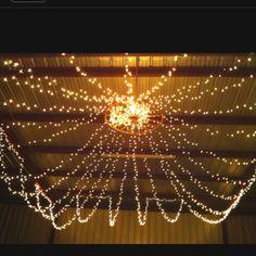Romantic Country Wedding Lighting Idea with Wagon Wheel.