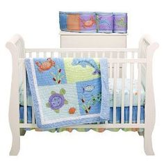 ocean themed nursery: this one's from target but pinterest wouldn't let me pin it.  tiddliwinks under the sea 4 pc bed set.