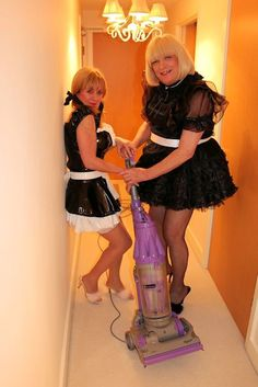 Sissy maids cleaning and fighting over the hoover.
