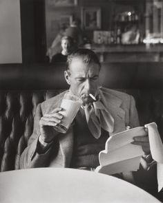 Gary Cooper drinks milk, smokes, and reads.