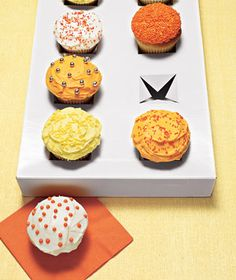 Cut X's into gift box to make disposable cupcake carrier.
