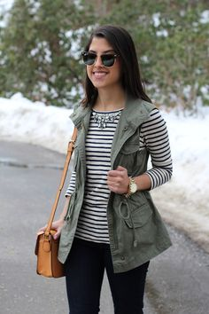 army green vest, striped top, black skinnies, black boots