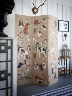 folding screen with dog images at Furlow Gatewood home