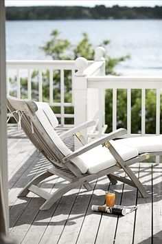 Sit and relax on this deck and look out over the lake. White railing.
