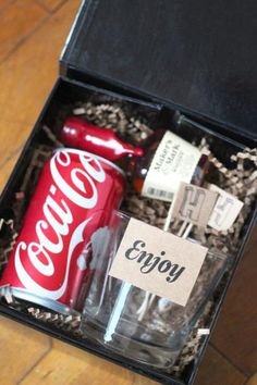 Gift to send over to the guys while getting ready. Perhaps a cheaper option would be a small bottle of coke with a mini bottle of liquor attached using raffia.