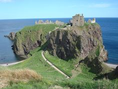 """Dunnottar Castle (Scottish Gaelic: Dùn Fhoithear, """"fort on the shelving slope"""") is a ruined medieval fortress located upon a rocky headland on the north-east coast of Scotland, about 3 kilometres south of Stonehaven."""