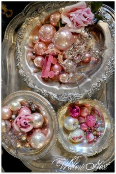 sweet pink ornaments in silver bowls