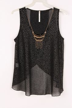 great summer top. black with white polkadots and jeweled neckline