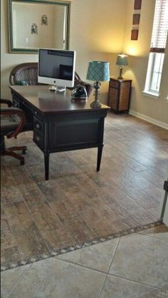 Wood look tile floors.   Transition with decorative tile inserts to transition from one tile floor to another.