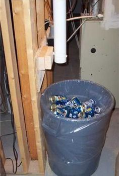 Pipe from upstairs drops cans into recycle container - could use this idea to drop recycling to outdoor recycling bins maybe