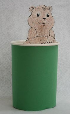 """Groundhog peeking out of his """"hole""""... can also be made using styrofoam cup, can create the grass with markers or crayons, glue groundhog to posicle stick and use like a puppet!"""