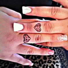 cUtE ♥ matching leopard heart tattoos!
