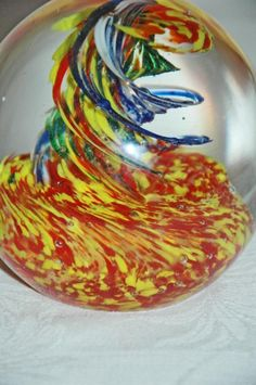 "Vintage Large Art Glass Paperweight Hand Blown Yellow, Blue Red Corkscrew Swirl  raising from a bed of yellow and red matter.   .   It is 4"" x 4"" and it excellent condition.   	The bottom is ground..."
