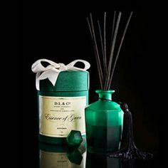 D.L. & Co Essence of Green Diffuser. Scents of basil, geranium and clove. Packaged in signature silk hat box with satin ribbon.