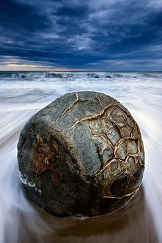 The Moeraki Boulders are unusually large and spherical boulders lying along a stretch of Koekohe Beach on the wave cut Otago coast of New Zealand between Moeraki and Hampden.