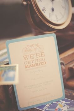 blue and taupe wedding invitations with bicycle detail // photo by GideonPhoto.com